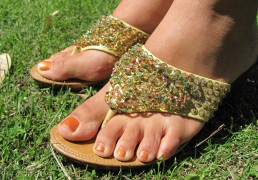 Hand-beaded wedged-heel thong sandals