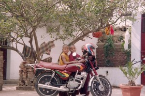 young monks and motorcycle
