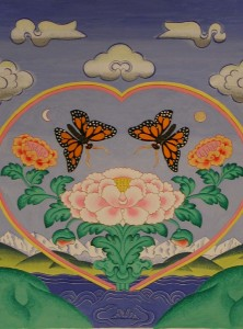 Two butterflies attracted to a blooming lotus surrounded by rainbow light